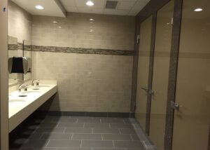 Biloba EVO hydraulic hinges installed in bathroom project at the World Headquarters of Jehovah's in New York.
