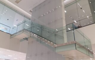 Spacers and fixing systems for glass